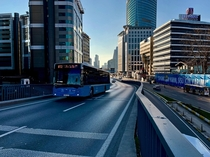 A gorgeous blue bus climbs over Bykdere Caddesi on a gorgeous blue day - stanbulEsentepe