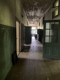 A hallway in one of three buildings that make up the abandoned Pleasant Hill Middle School in Hemingway SC An African American school built in  integrated in the s abandoned in the year  and added to the national register of historic places in