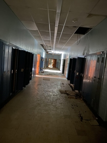 A hallway to an old abandoned school that me and a few friends explored last week very little graffiti all natural decay
