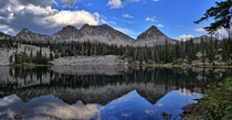 A high mountain lake in the Sawtooths of Idaho reflects and gives pause for reflection