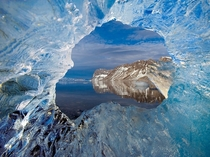 A hole in a glacier of ice frames Hornsund Spitsbergen Vikings may have found the far flung islands of Svalbard as early as the th century Photograph by Paul Nicklen