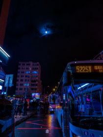 A humble bus beneath a nearly full moon in Mecidiyeky