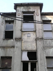 A Jewish building in Istanbul The first owner is Jewish and the second owner is Muslim Star of David and Maallah written with calligraphy together The building has been abandoned for a long time
