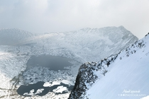 A jigsaw of ice on Red Tarn below Helvellyn The Lake District