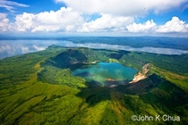 A lake within a lake - Taal Volcano Philippines  by John K Chua