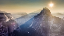 A light fog amplified shadows of Half Dome and Clouds rest making for a spectacular sunrise Yosemite CA