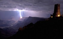 A lightning bolt crashes against the Grand Canyons South Rim