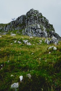 A limestone crag high above the Watlowes Dry Valley Malham Yorkshire Dales UK