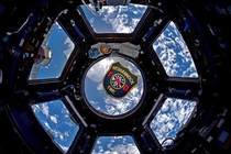 A local astronaut from my area recently went to the ISS and took a patch from my fire department to snap this awesome photo