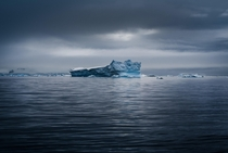 A lonely iceberg passing by in the Lemaire Channel of Antarctica Easily the most isolated place I have ever been