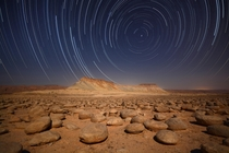 A long exposure during a full moon night at Limestone nodules filed - Negev desert - Israel