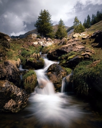 A long exposure of a waterfall in the morning after a nice camping with friends Switzerland Canton of Bern
