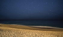 A long exposure shot at midnight on the beach in Cabo San Lucas Mexico