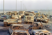 A long line of vehicles including destroyed Iraqi Army Russian-made T- tanks and trucks stand abandoned by fleeing Iraqi troops on the outskirts of Kuwait City on March   Pascal Guyot