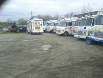 A lot filled with old ice cream trucks