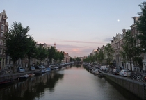 A lovely Amsterdam evening Full moon in the evening sky