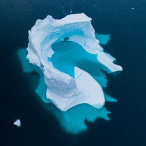 A Massive piece of ice as seen from the sky in Greenland x