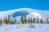 A massive snowdrift in the remote Canadian Tundra Northwest Territories