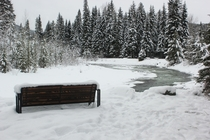 A memorial bench overlooks the Similkameen River in East Gate British Columbia Canada