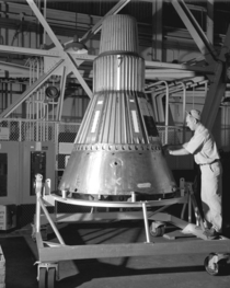 A Mercury space capsule being constructed in Lewis Hangar near Cleveland Ohio
