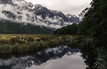 A misty morning on the Mirror Lakes in New Zealand