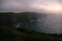 A misty sunset over the Cliffs of Moher Ireland