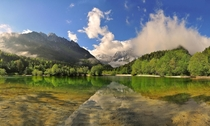 A Moment - on Lake Jasna in Kranjska Gora Slovenia  by Gitta Sladi
