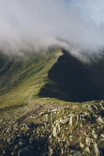 A moody morning looking up at Helvellyn from Swirral Edge Lake District UK