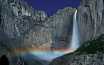 A moonbow or lunar rainbow is cast by the Yosemite Falls California