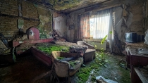 A moss covered bed in an abandoned bedroom by Haker Matthias
