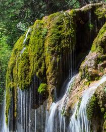 A mossy waterfall Hanging Lake at Glenwood Springs CO