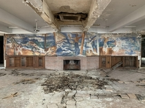 A mural left mostly intact in an abandoned military training facility