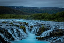 A naturally blue waterfall in Iceland x