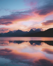 A near-perfect reflection during the best sunrise Ive ever seen at Lake McDonald in Glacier National Park Montana