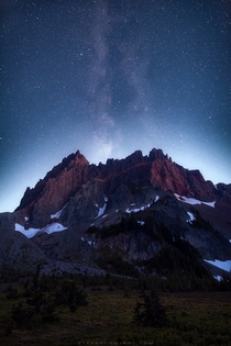 A nearly full moon sets behind Three Fingered Jack in Oregon obscuring the Milky Way core but providing an incredible glow behind the mountain