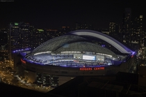A night time view of the Rogers Center in Downtown Toronto as the dome begins to close OC