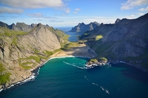 A Norwegian fjord with a beautiful sheltered beach  photo by Andre Ermolaev