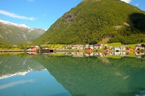 A Norwegian Village Over The Fjords and Its Reflection