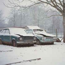 A pair of abandoned Ford Escorts close to where I live Shot this photo on film using an old Rolleiflex camera