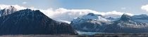 A  panorama I stitched together of some dramatic mountains in Iceland with a glacier poking out from the middle  liamsearphoto
