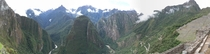 A panoramic view looking out from Machu Picchu onto the valley below