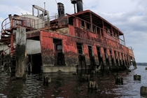 A partially sunk and rusting ferryboat in New jersey United states  by wombat