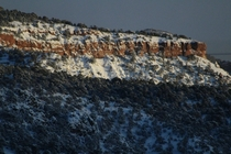 A partly snowy red rock ridge I saw while driving along Route  in southern Utah -