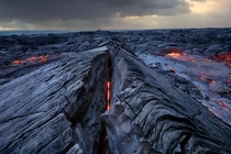 A peek directly into the glowing veins of Klauea the most active of the five volcanoes that together form the island of Hawaii  photo by Jason Matias