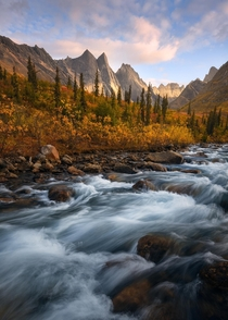 A perfect fall scene in the high arctic of Alaska The rushing creek beautiful fall color and jagged granite mountains in the background were a sight to see Gates of the Arctic National Park Alaska  mattymeis