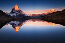 A perfect sunrise on the Matterhorn reflected in the mirror-like Riffelsee  photo by Sven Mller from rSchweiz