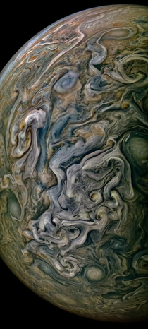 A photo from NASAs Juno is more like a painting