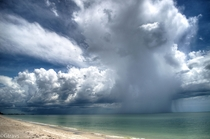 A photo I took of an isolated rain shower about  miles north of Naples Florida Greg Travers