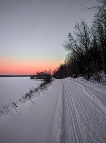 A photo of the snow covering the lake superior and the road in Upper Peninsula MI USA  Social naturehacked
