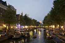 A photo to make you miss summer an evening on the canals of Amsterdam